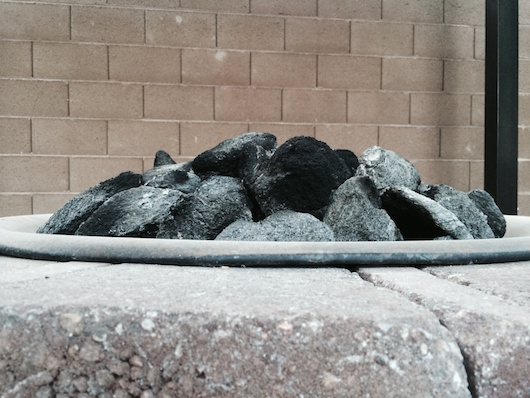 Side view: Lava feather rock in fire pit