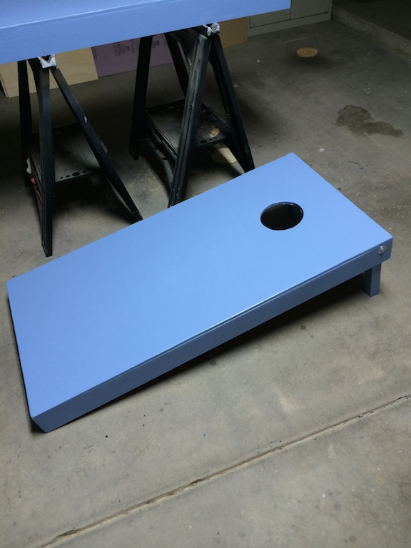 Cornhole board painted in meltmedia blue