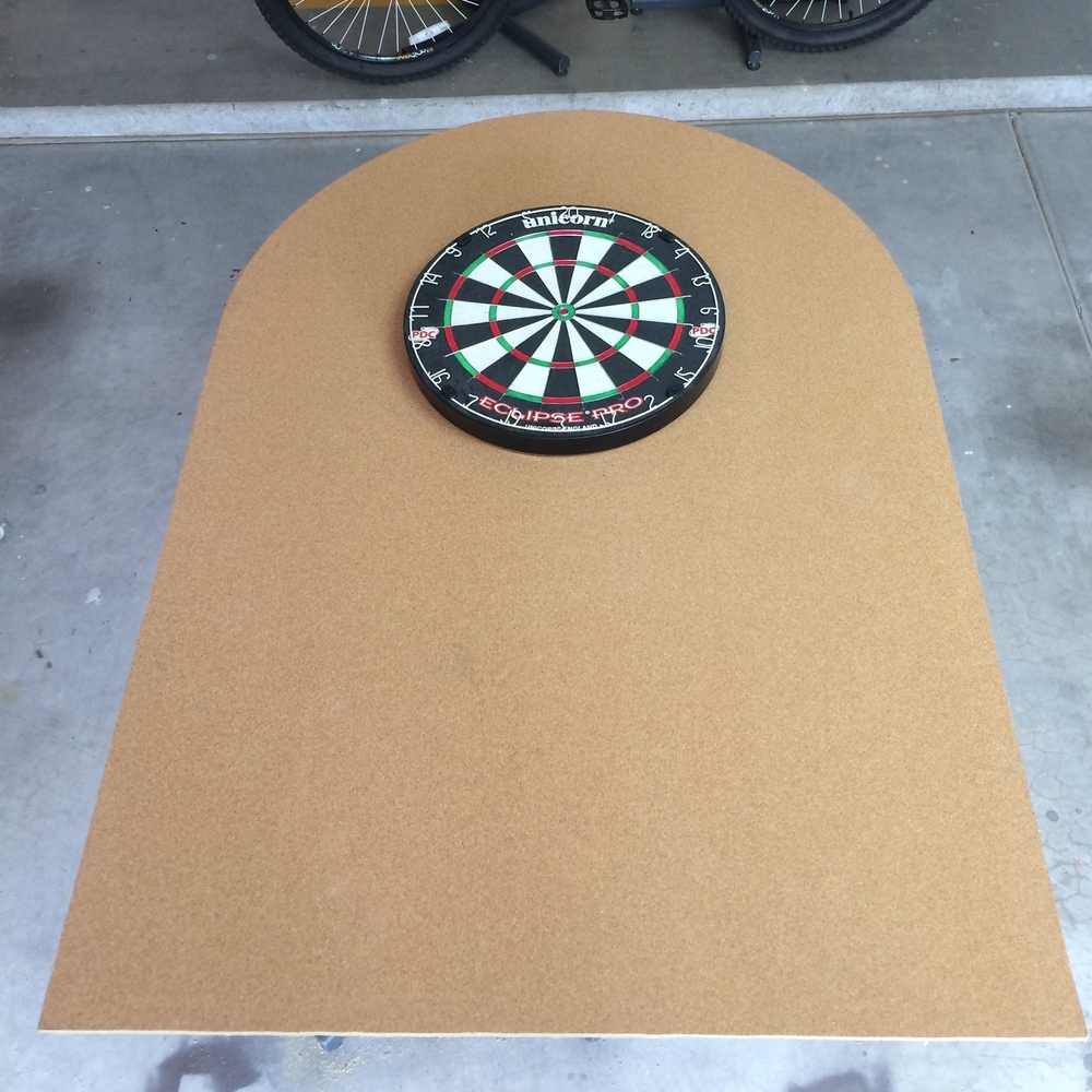 Cork board trimmed, dartboard centered in arc toward top