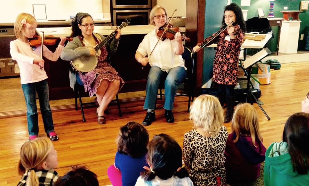 Abigail-fiddle, Camilla-banjo, Gretchen-fiddle, Lidija- fiddle  (NCCM photo)