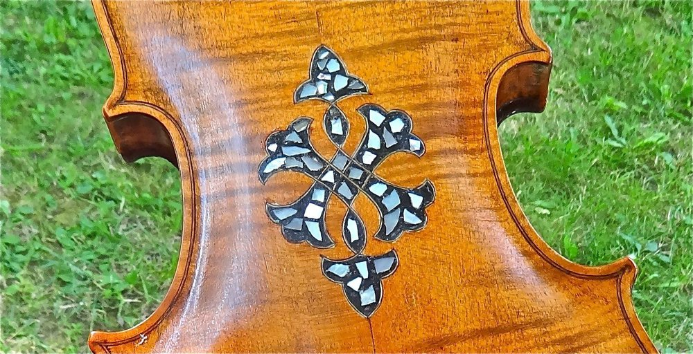 The engraved back of Jean LeRoux's fiddle.