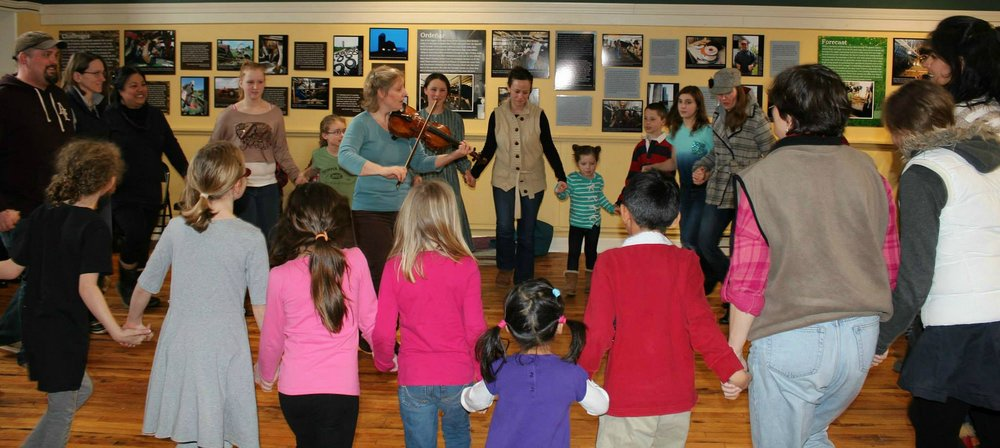 Fiddler/dance caller   Gretchen Koehler    teaches the dance  La Bastringue.      (Courtesy of TAUNY archives)