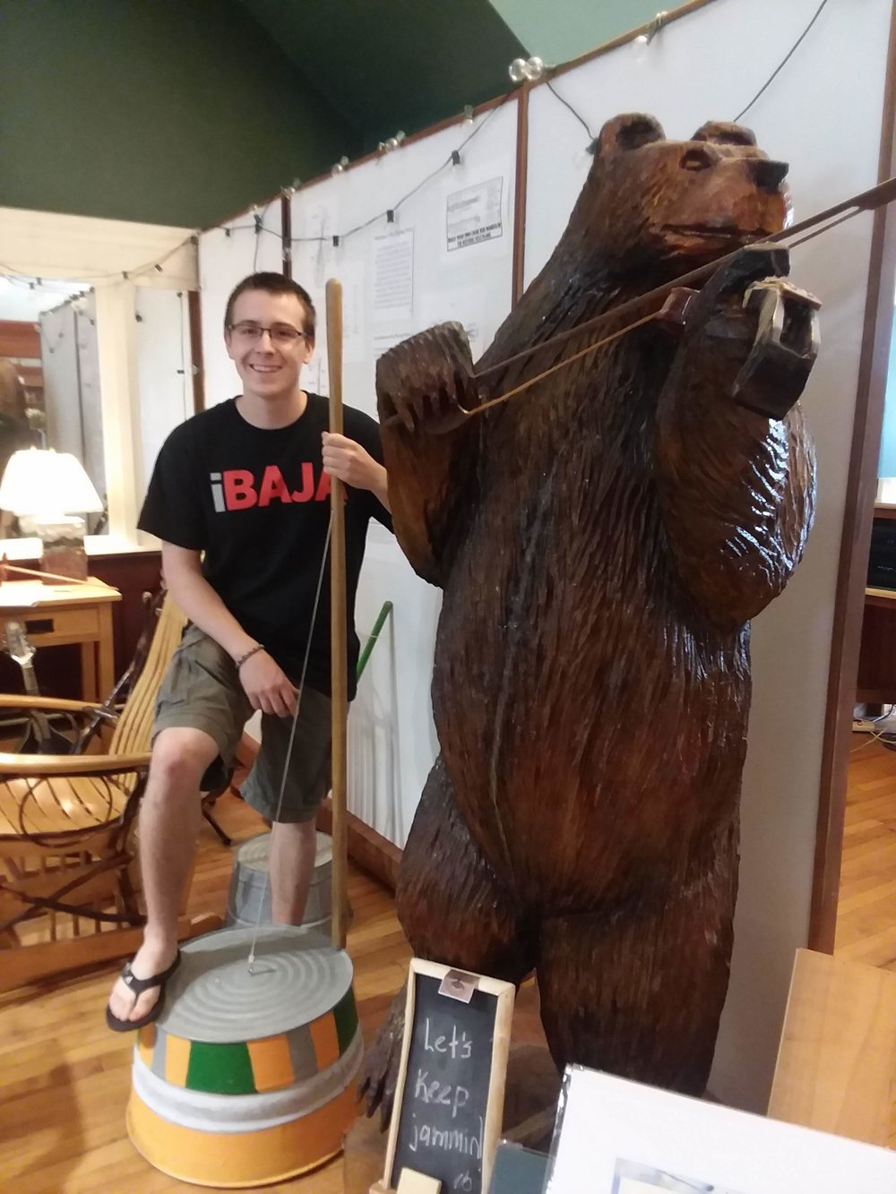 "Gaetan Foisy (above) in the ""Playing Parlor"" demonstrating a washtub bass he donated for visitors to try. He made several basses with his neighbor/washtub bass aficionado, ""Downtown"" David Brown."