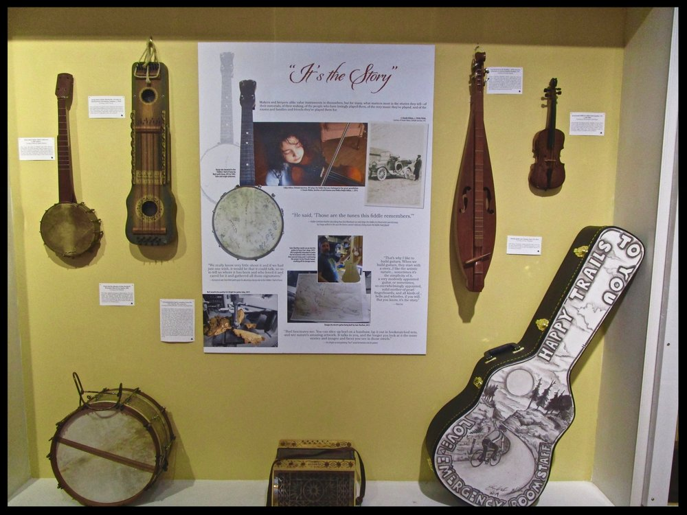 A variety of instruments from home collections, North Country museums and historical societies on display in the TAUNY gallery. Young Lidija Aldous (fiddle student of Gretchen Koehler) pictured playing the fiddle of J. Claude, Aldous, her great-grandfather.