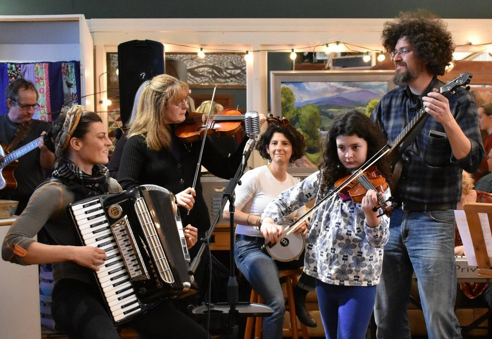 The result of encouraging to my students to play together as FAMILY & NEIGHBORS. Mom on accordion, Babooshka (grandma) on fiddle (first concert!), their friend on Dumbek, Daughter on fiddle, Dad on banjo. (InSil Yoo Photo)