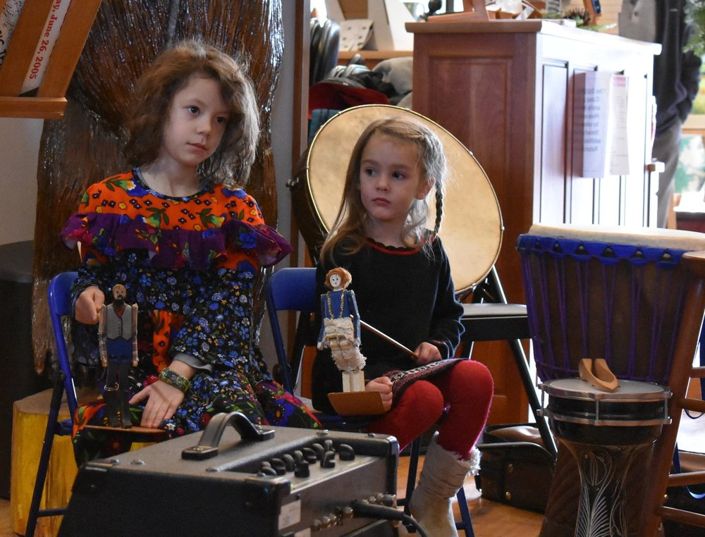 A fiddler's daughter + fiddler's sister play limber jacks.