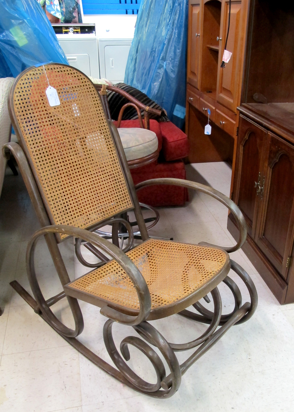 The antique bentwood rocking chair was $10 and needs a new seat. I just watched a  recaning rattan  tutorial and plan to go back and purchase if it is still available. This rocking chair style is fairly common but the lines are beautiful and it is a great price.