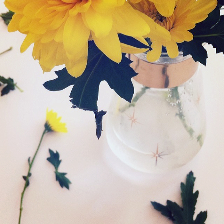 Flowers add cheer to the gloomiest of days. (In a thrifted vase, of course.)
