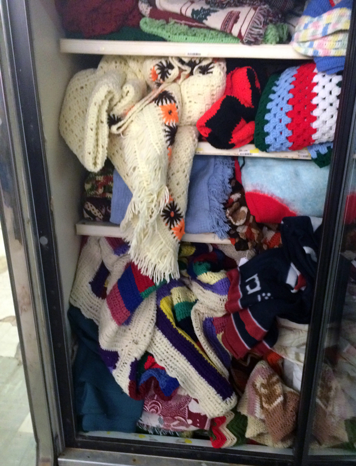 thrift store blankets in a freezer chest