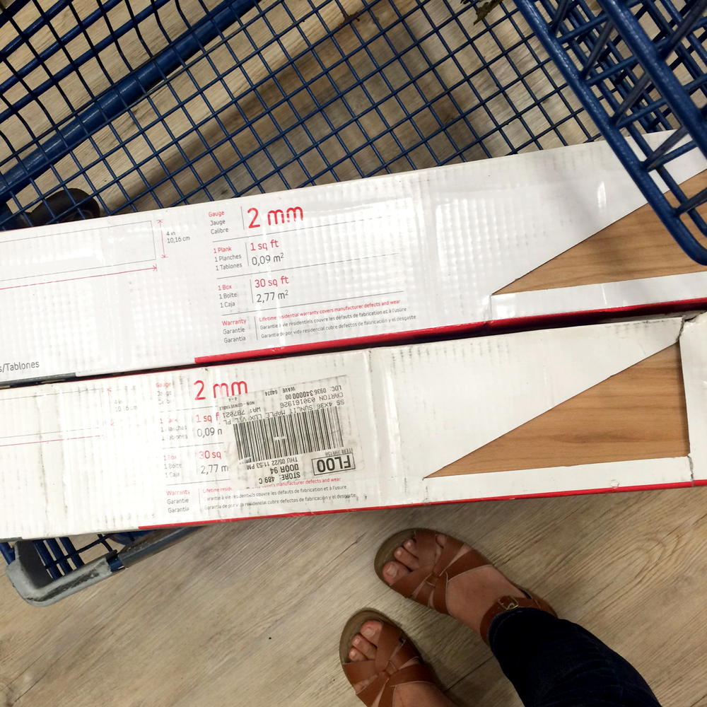 selecting the peel and stick flooring at Lowes