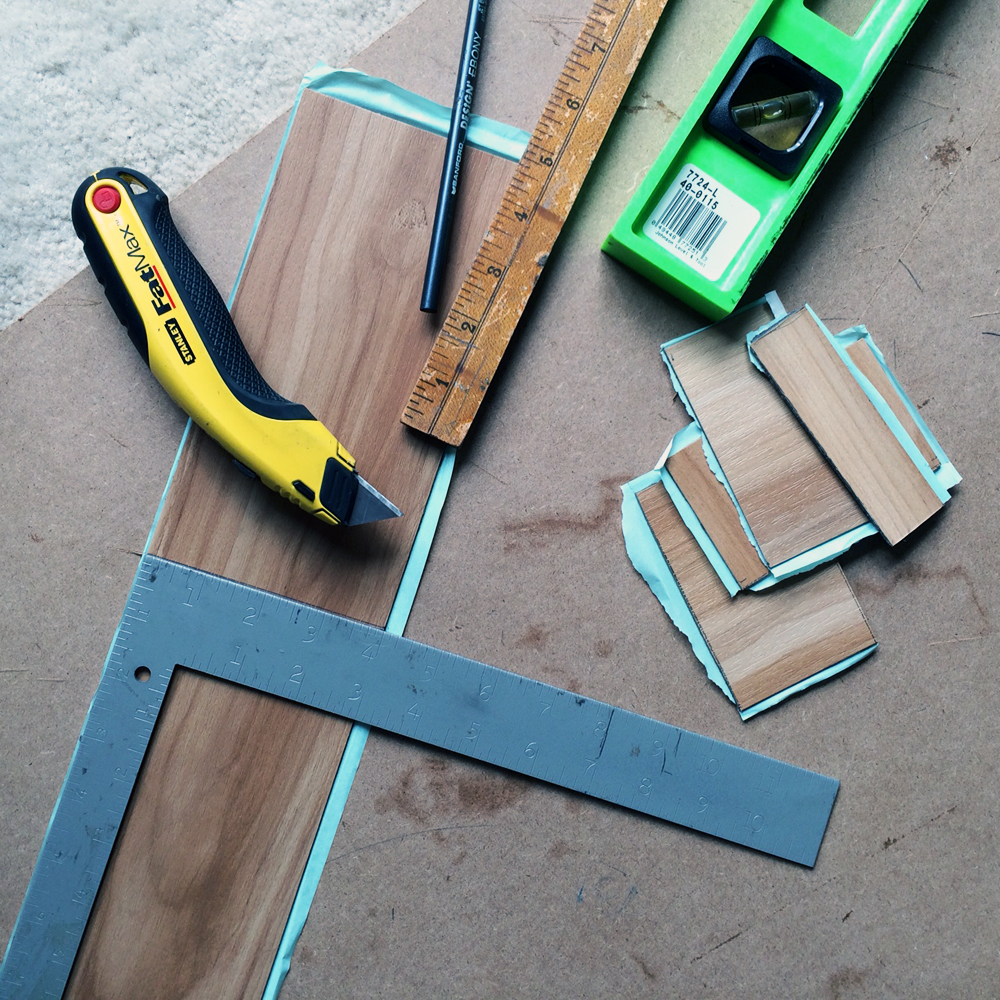 score the flooring with a sharp box cutter