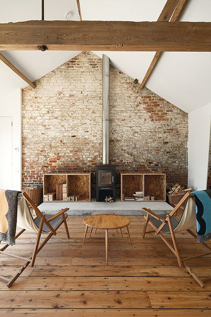 add a brick wall to high ceilings to warm up the space