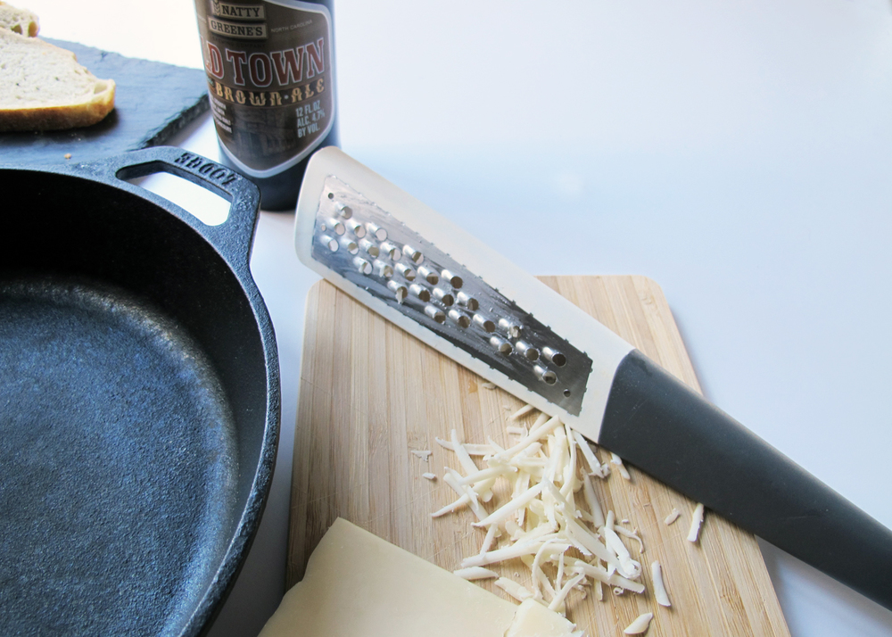 how to make beer cheese dip // shred 1lb gruyere cheese