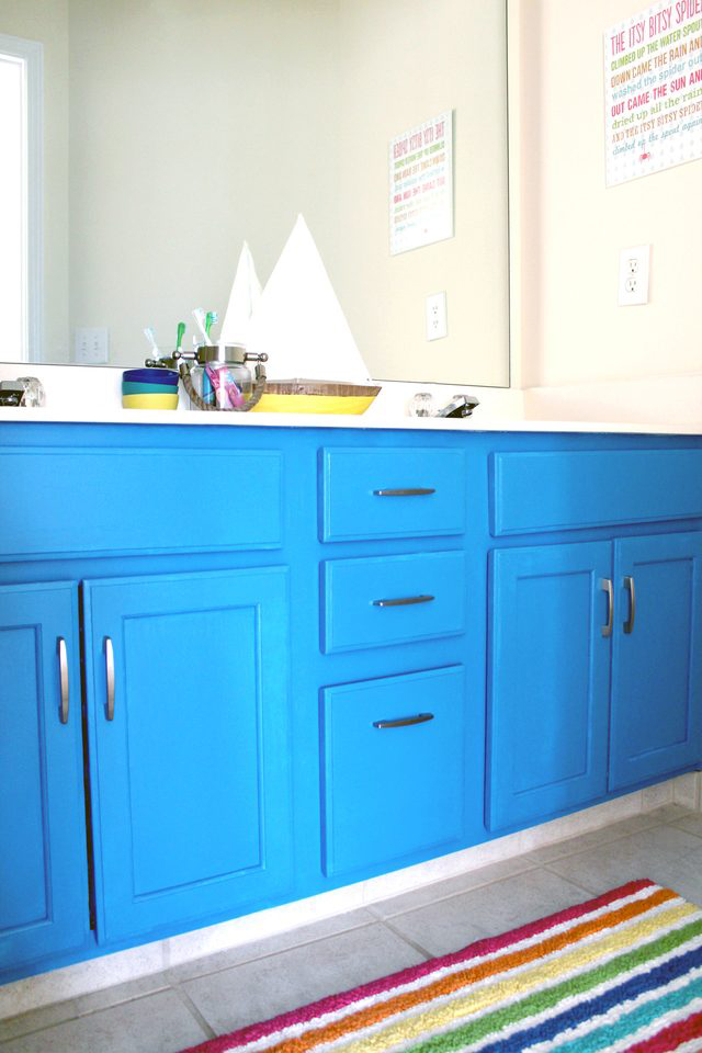 learn how to paint your 1990s oak vanity for under $100 (with new hardware!). fun project for a kids' bathroom   via Tag&Tibby