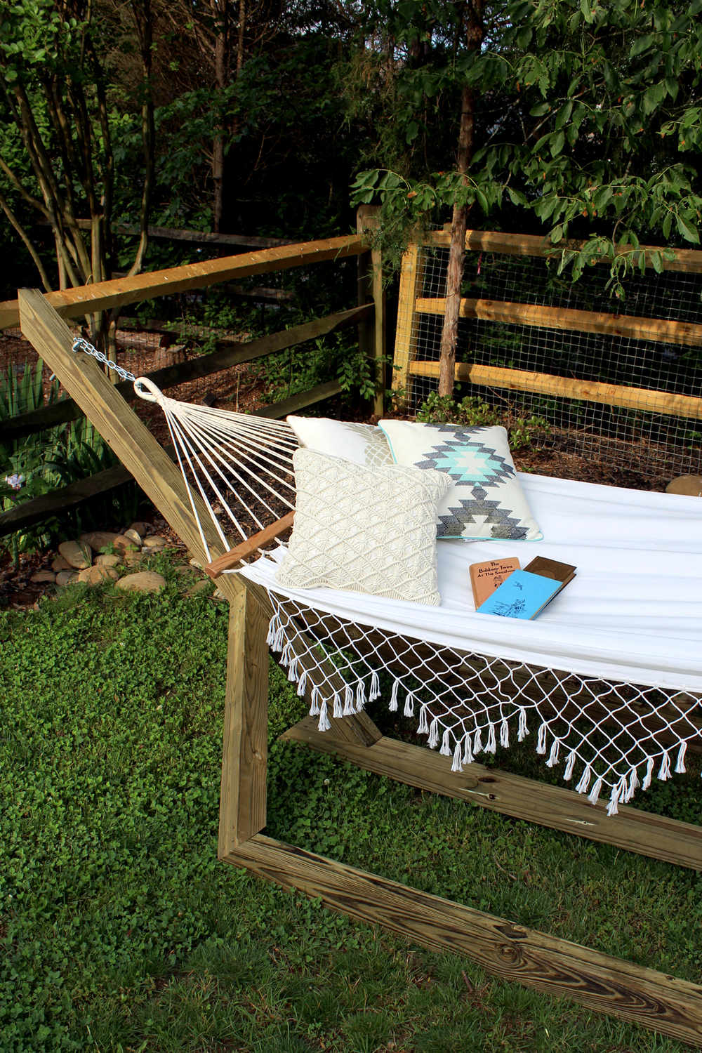 learn how to make this wood hammock stand for $60. fun staycation idea!