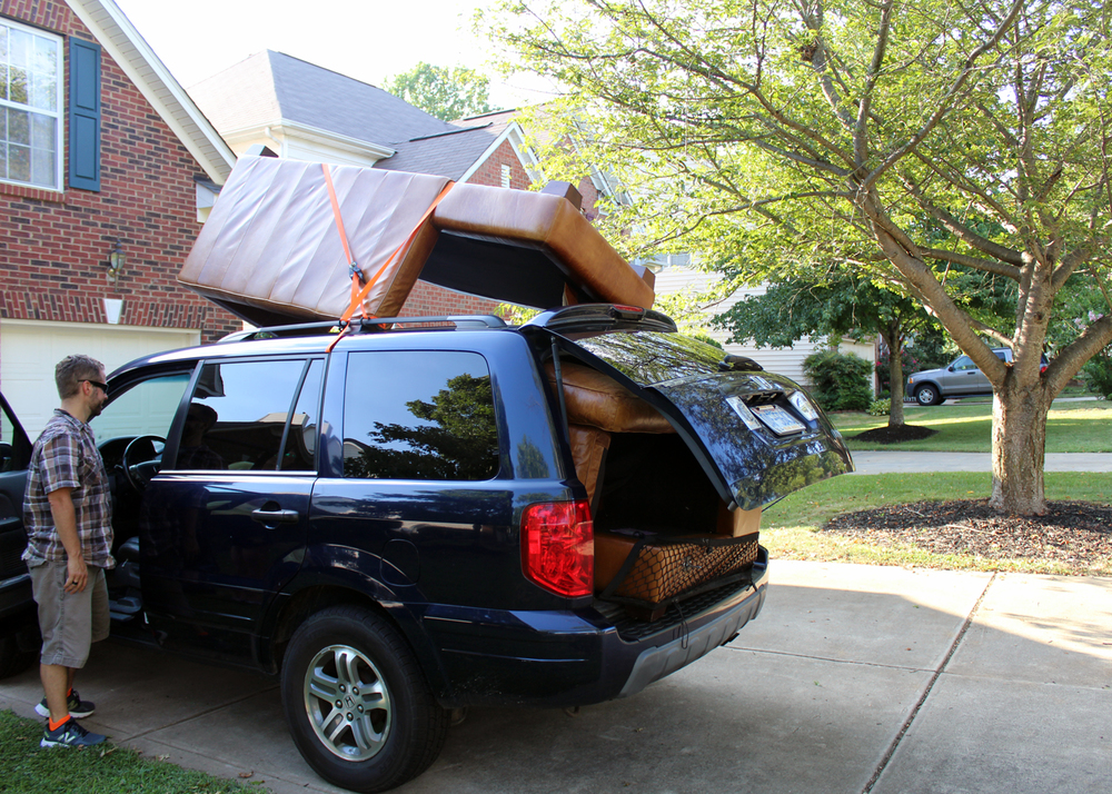 How my husband managed to fit a full sized sectional leather sofa into our Honda Pilot in 1 trip--I'll never understand! (Though he did have a wonderful friend help load/unload, thanks Matt!)