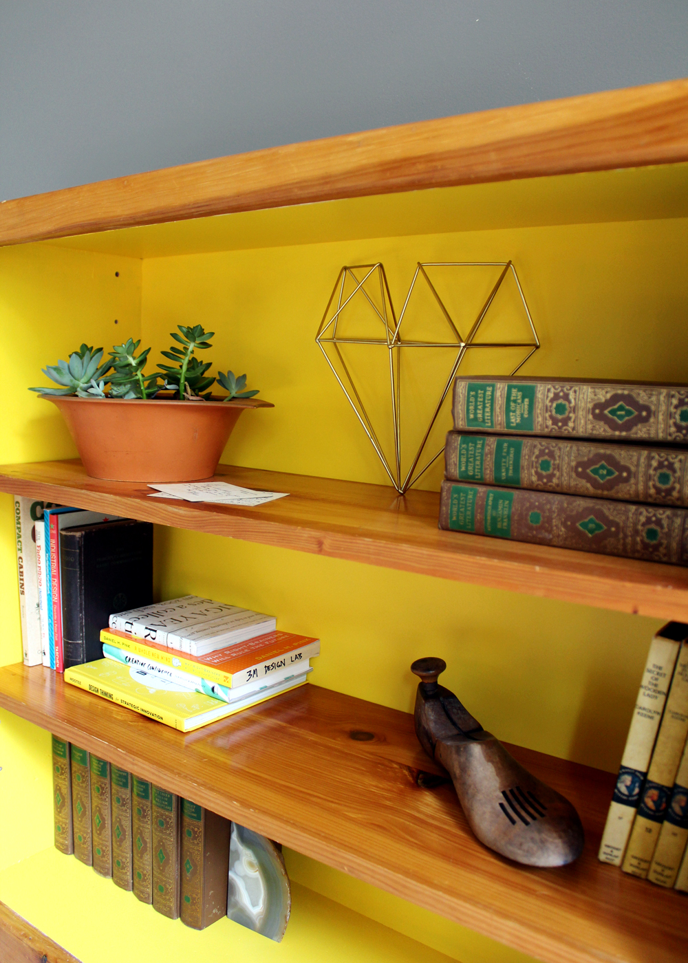 DIY thrift store bookcase painted Sherwin Williams Cheerful with vintage accents | Tag&Tibby