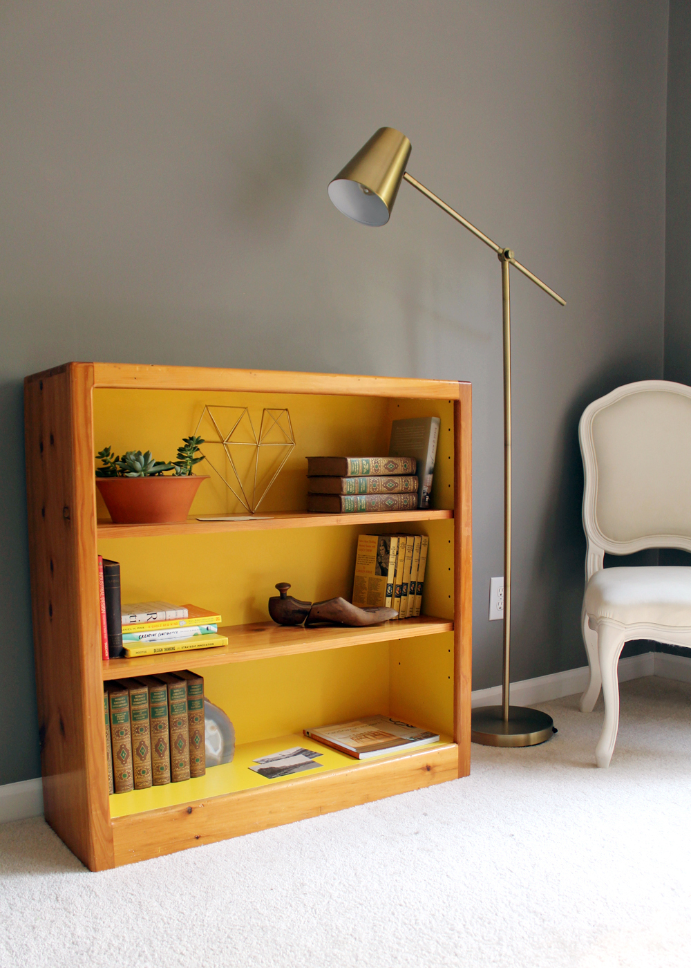 DIY thrift store bookcase painted Sherwin Williams Cheerful. (walls painted SW Dovetail Gray) | Tag&Tibby