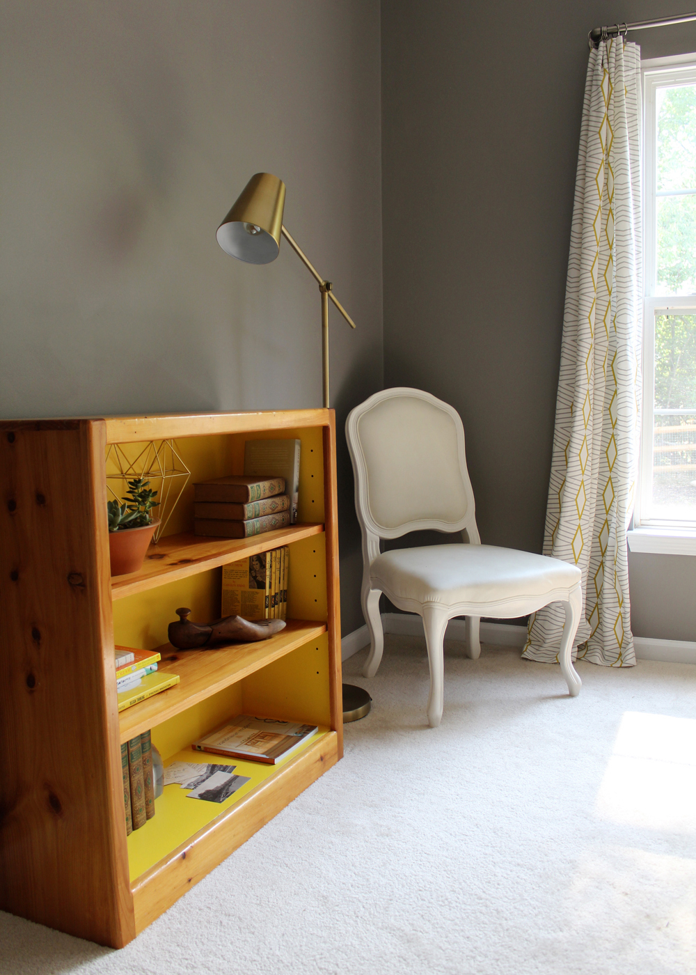 tips for painting a bookcase bright yellow (DIY thrift store bookcase painted Sherwin Williams Cheerful) walls painted SW Dovetail Gray