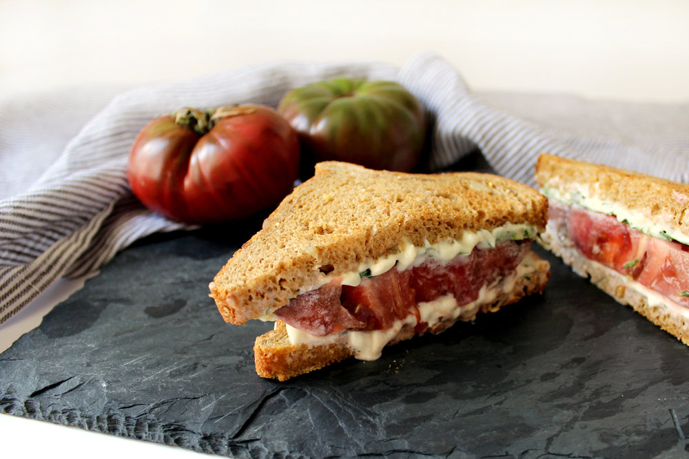 A spicy tomato sandwich recipe with basil, jalapeño, heirloom tomato
