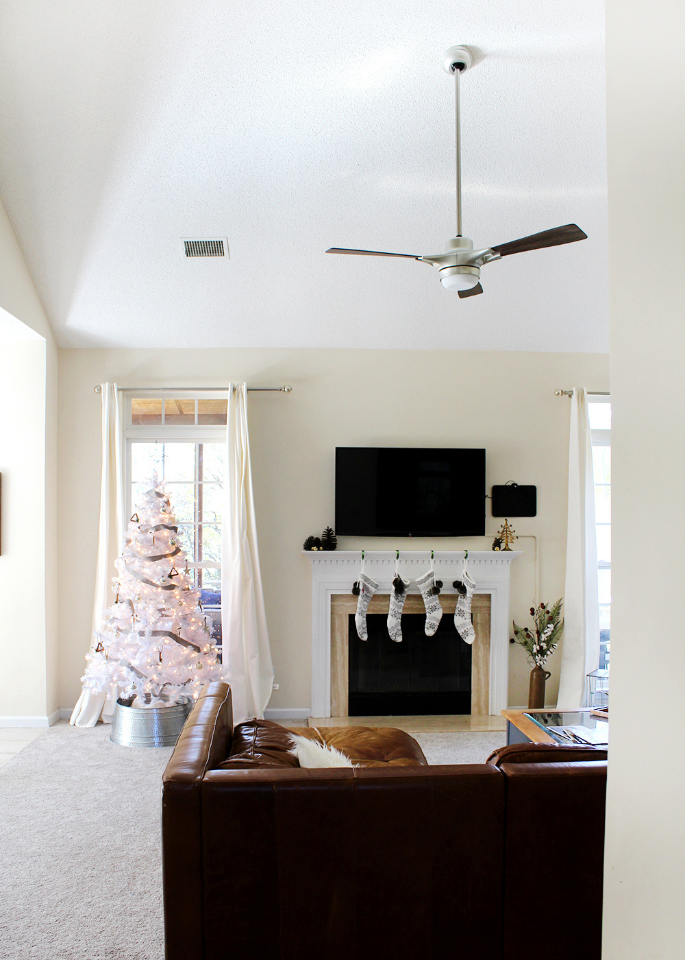 love the simple white decor and tree! A Modern Holiday Home Tour | Christmas decor