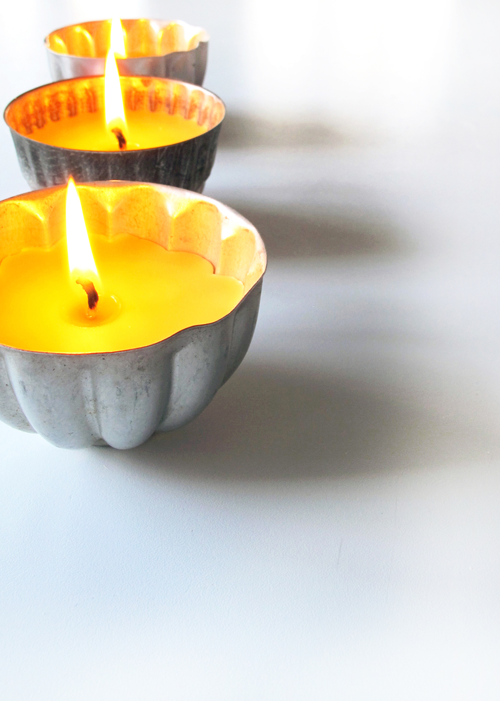 DIY homemade beeswax candles in vintage jello tins