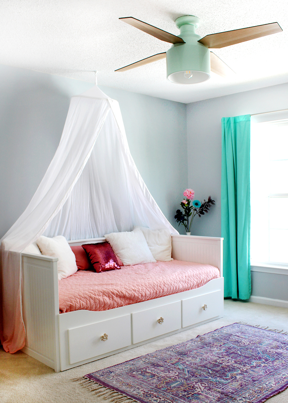Girl's bedroom with SW Misty blue paint & Cranbrook ceiling fan