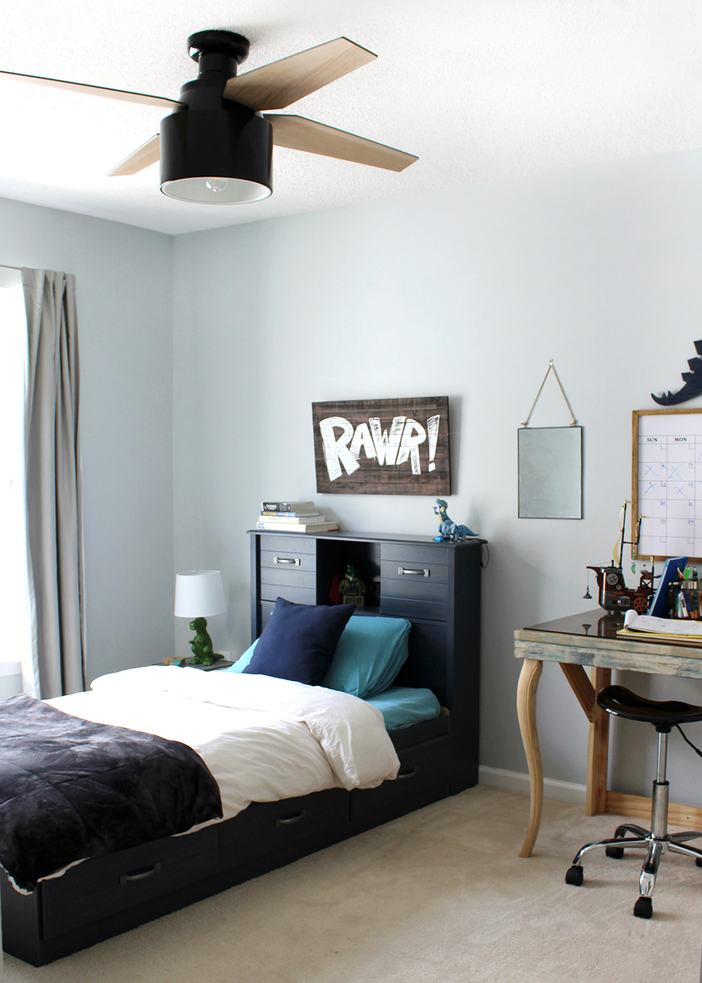 preteen boy room with blue walls and a modern black ceiling fan #kidsroom #kidsbedroom #teenroom #preteenroom