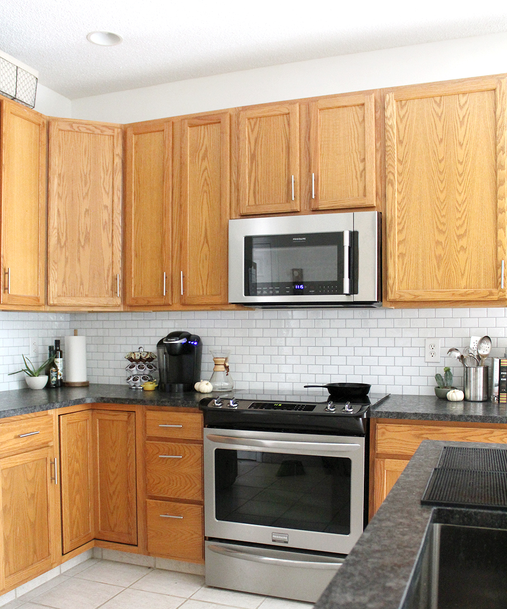 oak kitchen with peel & stick subway tile and updated hardware