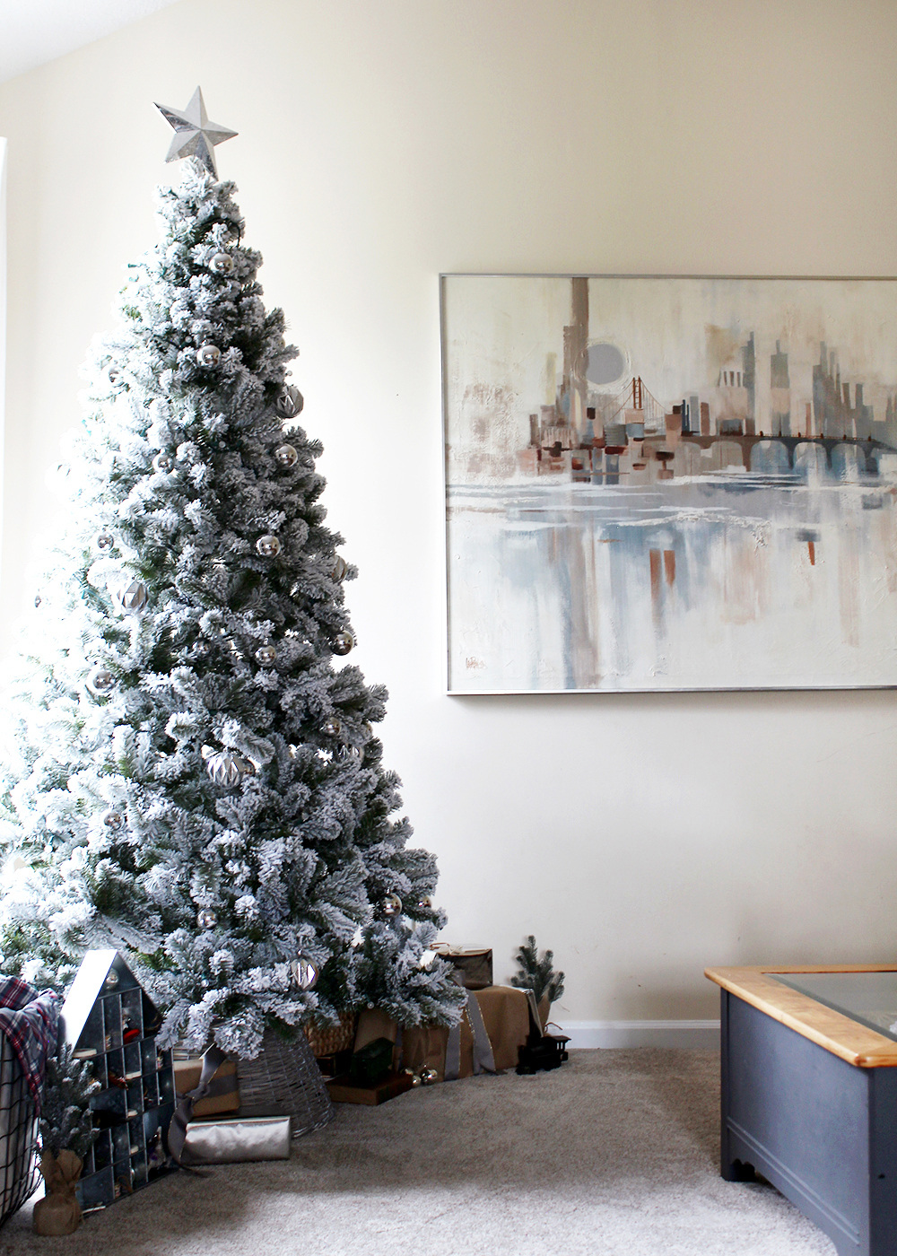 an 8 foot modern flocked Christmas tree with lights off #ChristmasDecor #FlockedTree