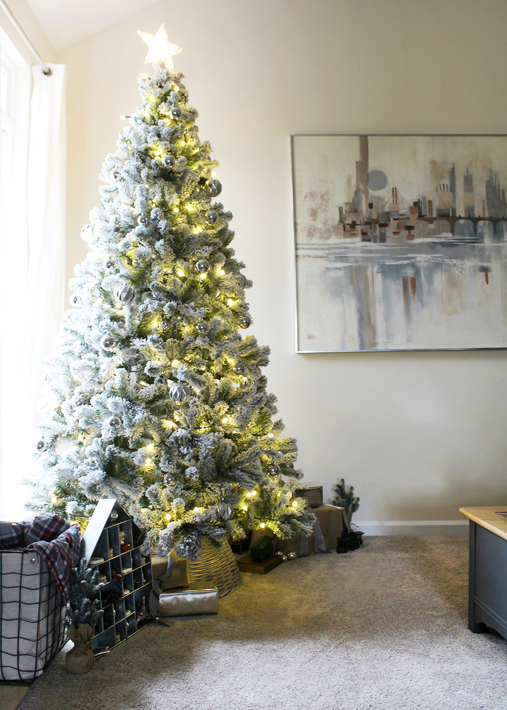 A modern flocked Christmas tree with silver ornaments #ChristmasTree #FlockedTree #ChristmasDecor
