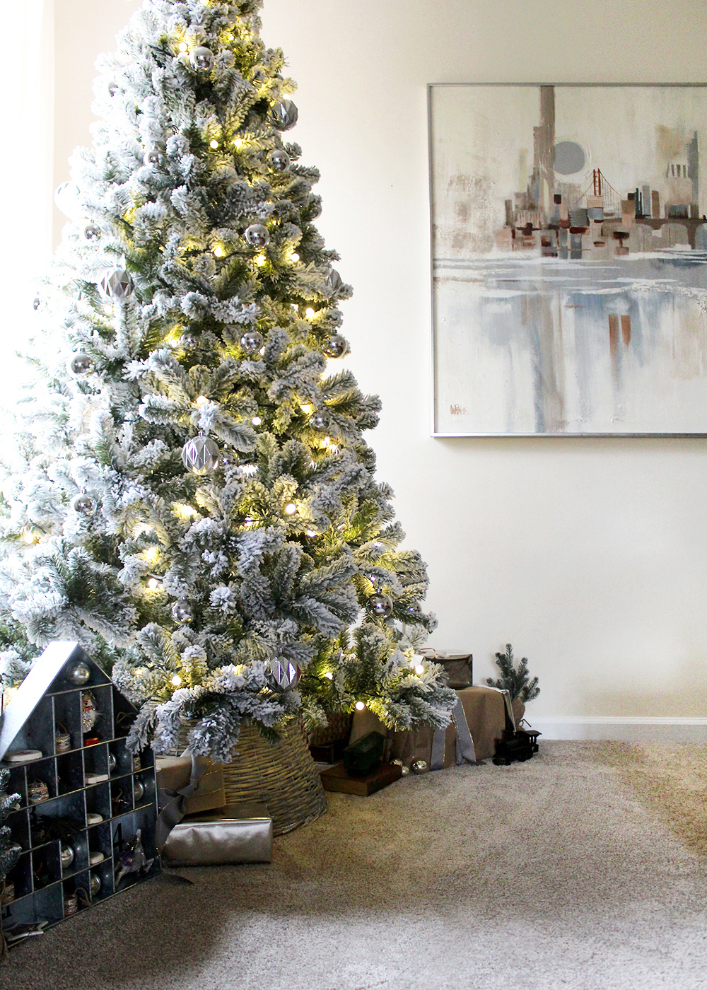 A simple, modern flocked Christmas tree with silver ornaments #ChristmasTree #FlockedTree #ChristmasDecor