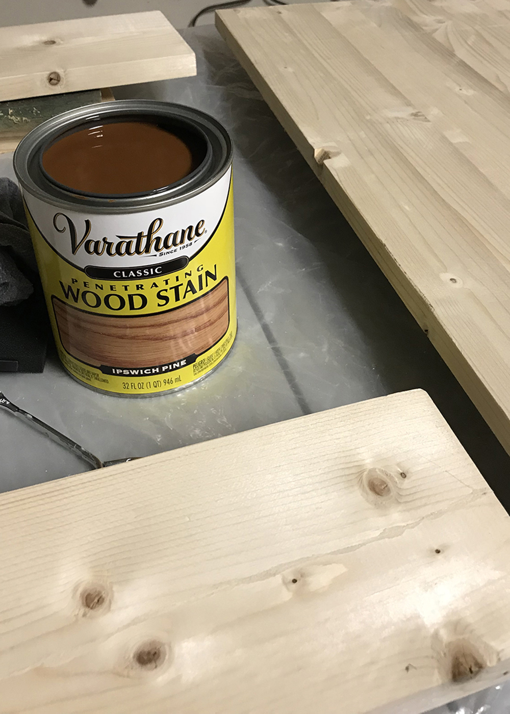 Staining the wood shelves