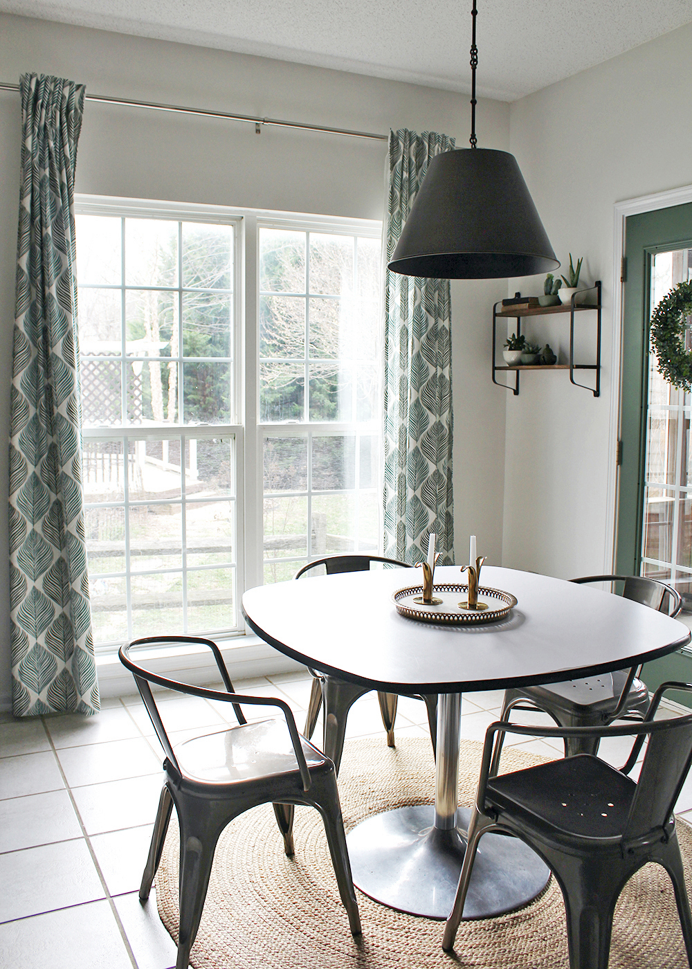 Before & After breakfast nook on a small budget | white walls with green french door