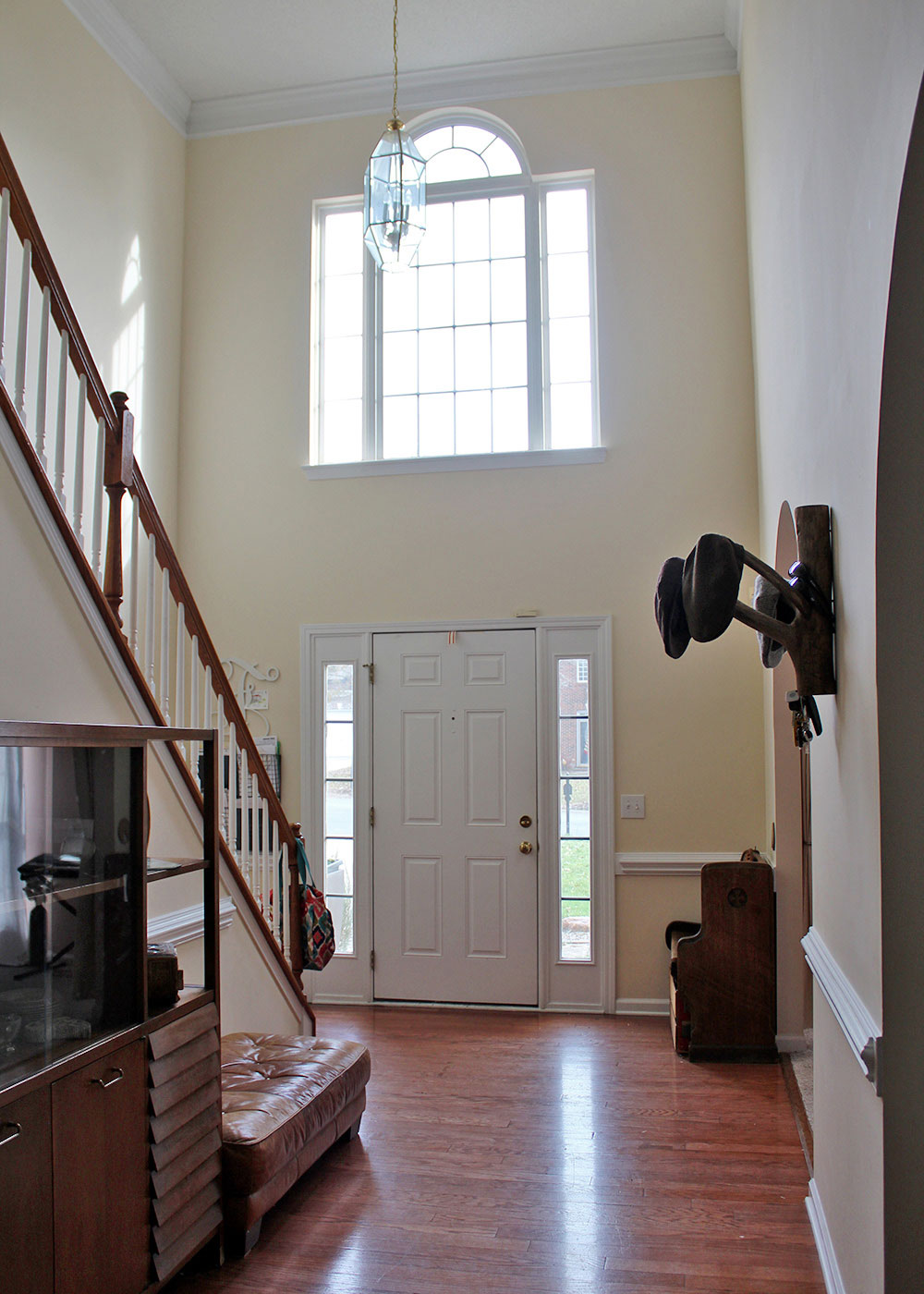 home entryway with high ceilings (before makeover)