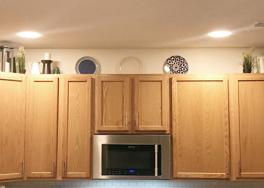 testing out plates over cabinets