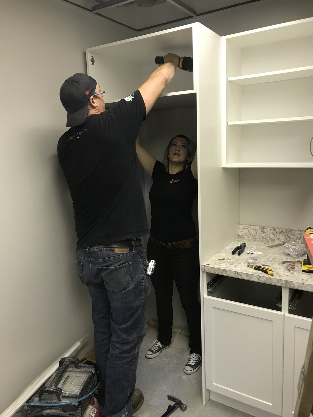 Teamwork To install Cabinets
