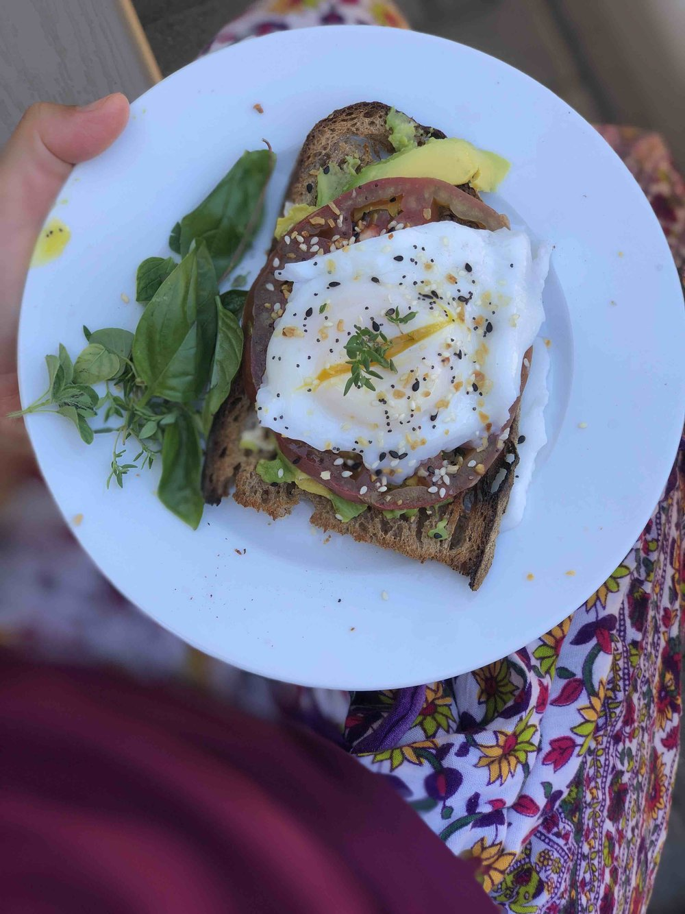 Farm Egg and avocado sourdough toast with garden herbs