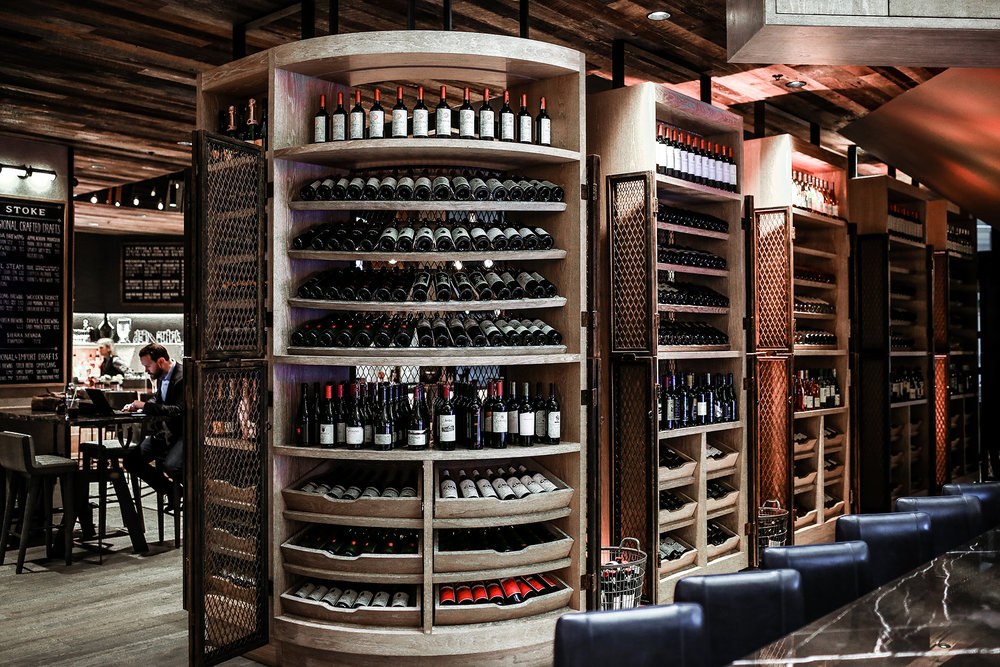 A small wine shop which offers wine at retail prices not just to the guest but also extends wine delivery service to the local community.