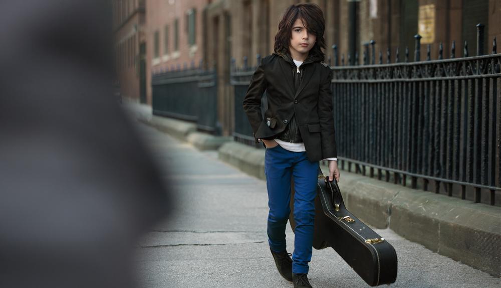 DKNYF12_INTL_Boy guitar-FPO.jpg