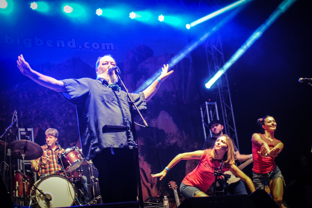 Kevin Russell, of  Shinyribs jams out with his dancing girls.
