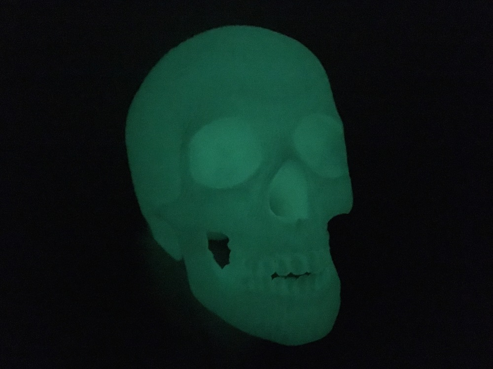 Life size 3D print of a human skull using glow-in-the-dark PLA filament