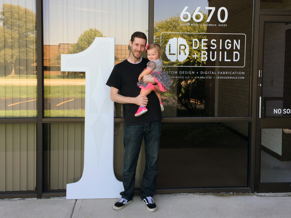 Christopher with daughter Kailaa celebrating her and LR Design+Build's first birthdays
