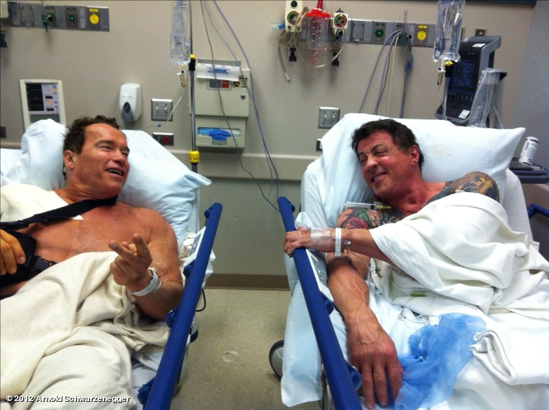 """natandmarie :     BE STILL MY HEART!!! Is that Arnie and Sly, I spy with my little eye? Why is the Internet SO AWESOME!   YUP, looks like Arnold Schwarzenegger and Sylvester Stallone happened to rendez-vous at the hospital at the same time for shoulder surgeries.   """"After all the action, stunts and physical abuse shooting 'The Expendables 2' and 'The Last Stand' it was time for a little tune up on my shoulder,"""" Arnie  tweeted .""""Look who was coincidentally waiting in line behind me for his shoulder surgery. Now we're ready for another round of great times and action when we shoot 'The Tomb. #greattobeback.""""   Hold on, I knew about  Expendables 2  (and the AMAZING inclusion of Chuck Norris and JEAN-CLAUDE VAN DAMME *14-year-old me is swoooooning*).   But what is The Tomb?? According to IMDB it's an action thriller about a master prison architect (Sly) who gets framed and thrown into one of his own escape-proof prisons and tries to escape with the help of his inmate (Arnie).   YES!!     Holy Cow that's cool! haha"""