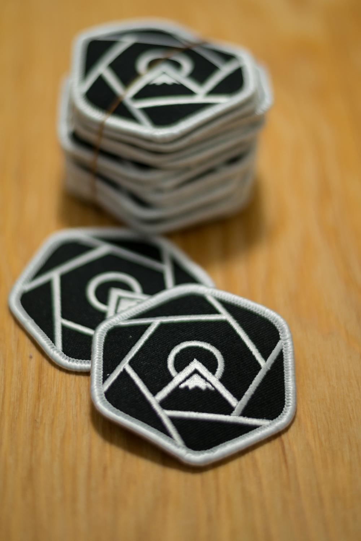 Capture Beyond Limits logo patches.