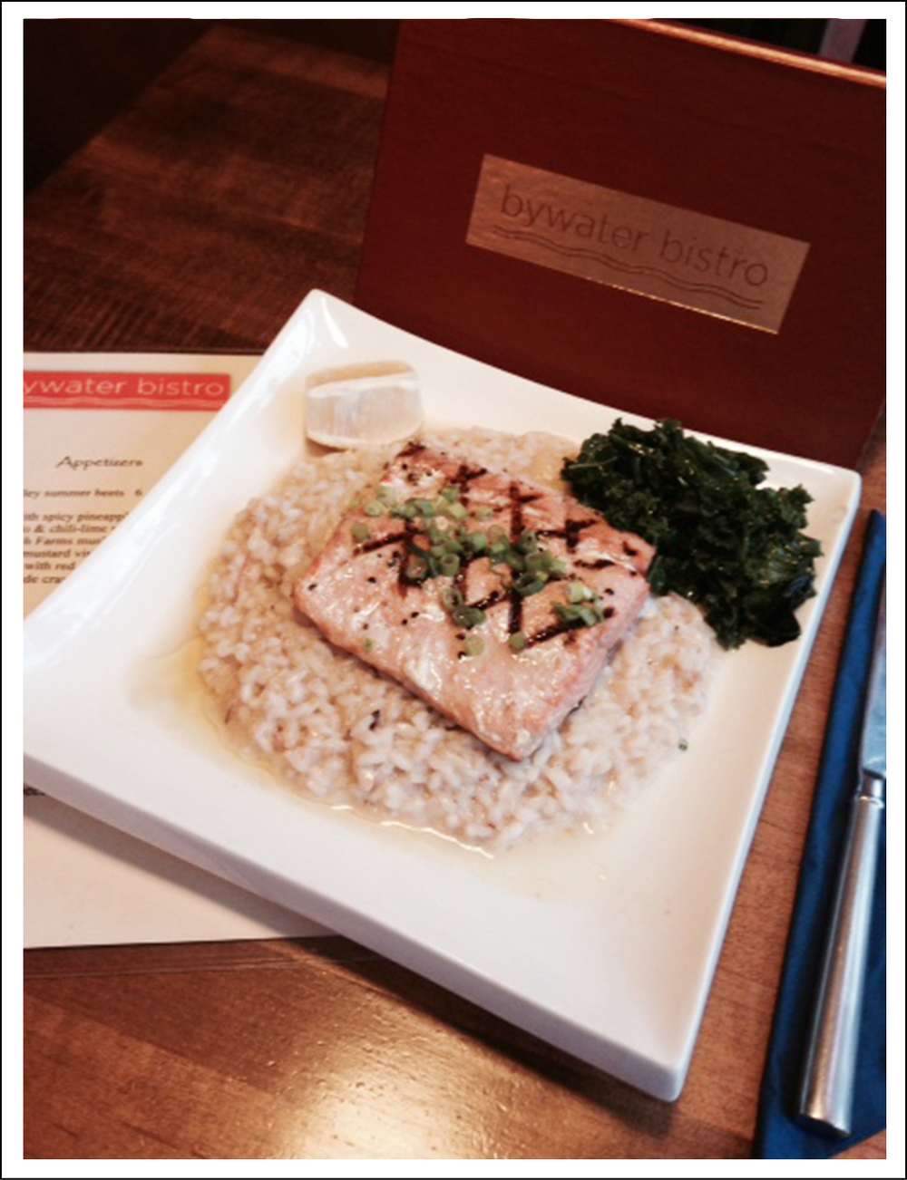 Wild Caught Salmon, Grilled with green onion vinaigrette over blue crab risotto.