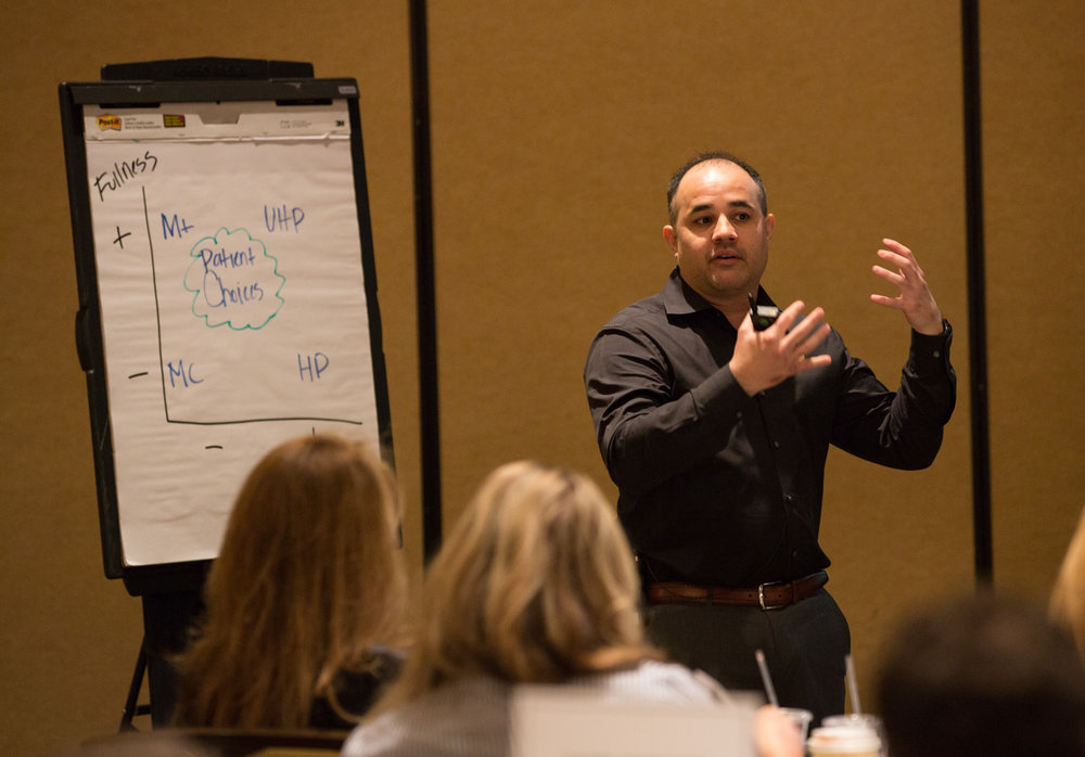 Genaro Guerra speaking at the Johnson & Johnson Mentor Worldwide 2015 National Training Meeting.