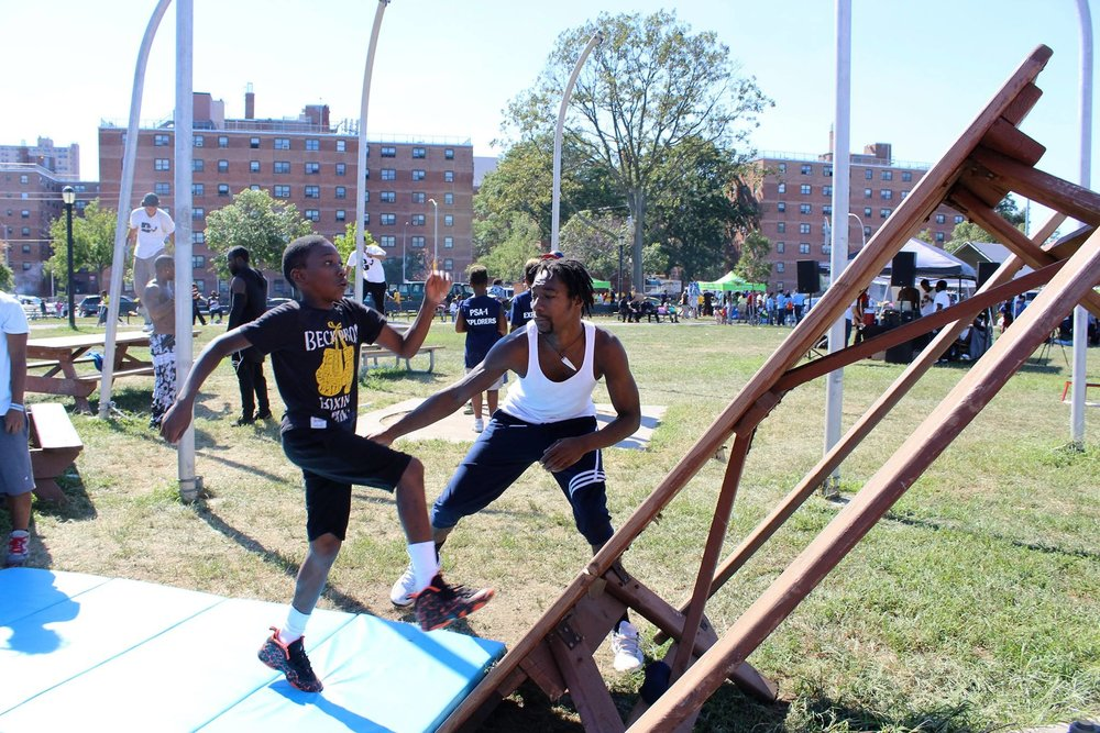 """Certified Parkour Instructor Shane """"Sage"""" Samuel teaching parkour at the 2016 NYPD Explorers Extravaganza Photo by Brittany N. Diblasio"""