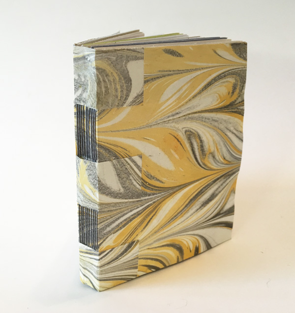 I'll be teaching this style of cross-wrapped binding on Saturday, Dec. 10 from 1-5 pm at  Createful Studios  in San Rafael. It's a softcover binding that works well as a journal or as a sketchbook because it opens flat. I made the marbled paper cover and used matching waxed thread to create this 4-1/4 x 5-1/2 inch, 40-page book.  Link to class.