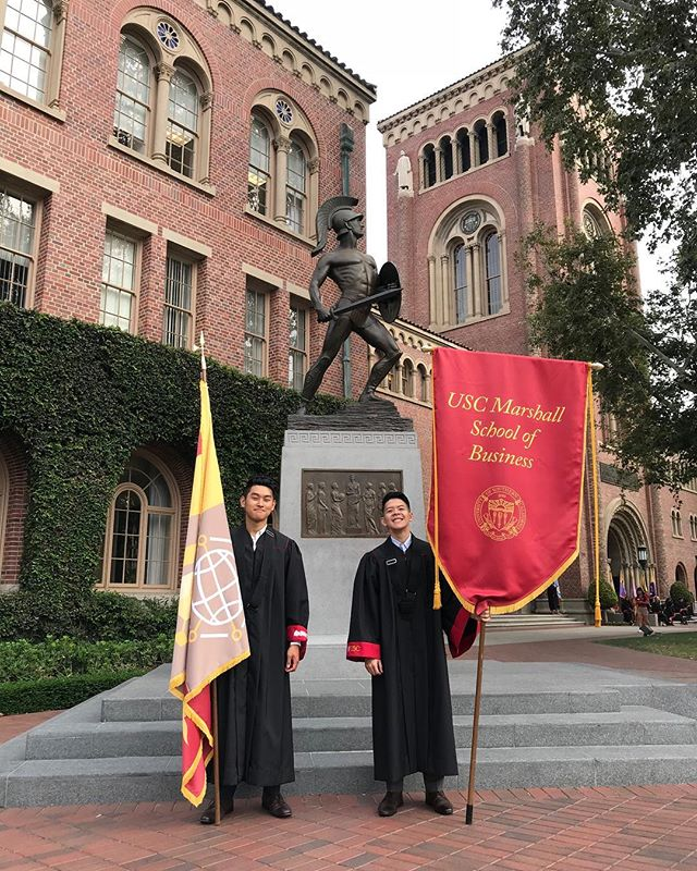 #TBT to our Brothers Weber Wong (Fall '16) and Tomy Duong (Spring '17) repping @uscmarshall as the official flag bearers! 💸